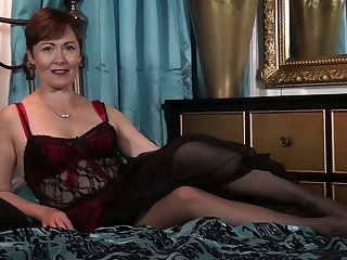 Dirty-minded lady with sinister hair is happy to fingerfuck her mature pussy