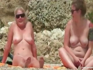 Not later than our holiday my wife and my busty band together us by going naked on the beach.