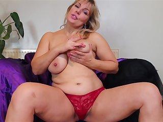 Plump chubby busty mature amateur MILF Danielle strips convivial