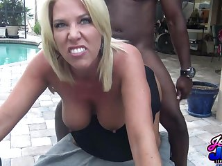 Smiley mature gets eaten at large and fucked by the pool