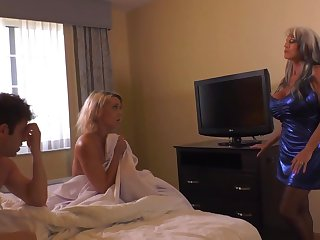 Insatiable blond damsel and her naughty pals are having a threeway, close to a motor hotel apartment