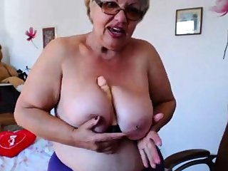 Granny playing with  broad in the beam boobs on webcam! Amateur!