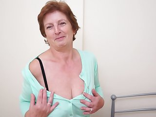 Solo granny Slicklips moans while she drills her cunt with a toy